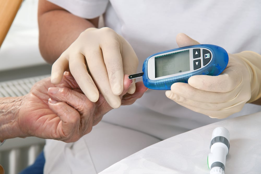 blood glucose meter. the blood sugar value is measured on a finger